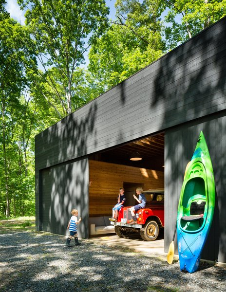 The spacious detached garage stows a bevy of kayaks and inner tubes, not to mention the family car.