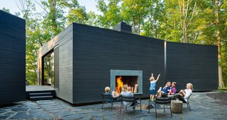 Katie and Danny MacNelly met as University of Virginia architecture students and started their own practice, ARCHITECTUREFIRM, along with another former UVA classmate. Together, the couple designed and built their family's country retreat, a three-volume residence near Virginia's James River.