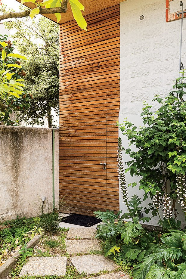 A cedar-clad door in the front provides a shortcut to the backyard.  Photo 6 of 7 in Now That's How You Double Your Square Footage