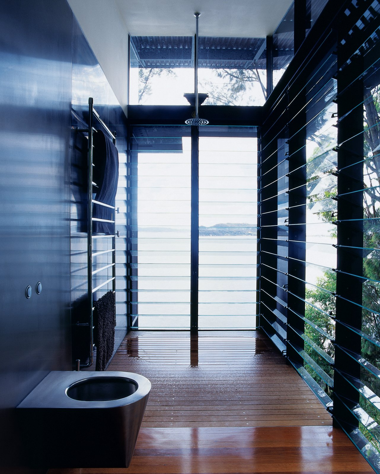 Bath Room, Medium Hardwood Floor, and Open Shower Even the master bath is open to the surrounding water.  Best Photos from Three Glass-and-Copper Pavilions Conquer the Cliffs