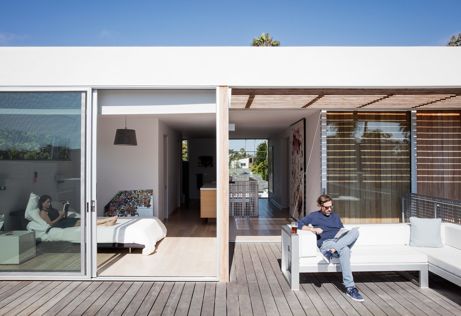 Exterior, House Building Type, and Flat RoofLine Tracy and Thaddeus enjoy an afternoon read from the master bedroom and terrace, respectively; the outdoor sectional is by Gandia Blasco.  Best Photos from Amid a Hotbed of Architecture, This Home Holds Its Own