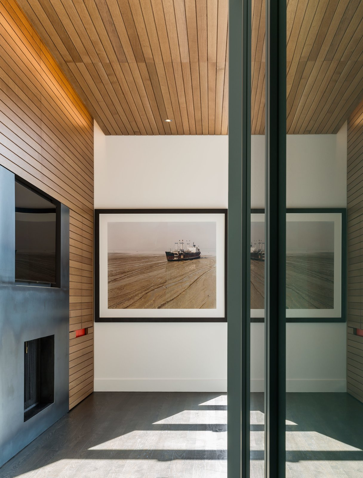 Living Room, Gas Burning Fireplace, and Concrete Floor When closed, the miniature workspace vanishes into the detailed white oak millwork by KWI Cabinetry.  Photo 10 of 16 in Four Floors of Gadgets and Gardens in Chicago