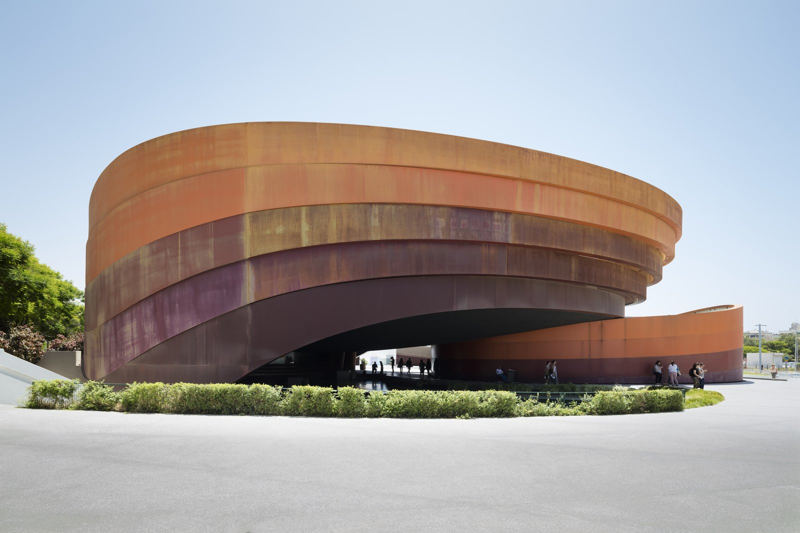 Design Museum Holon, Israel's national design museum, hosts a retrospective exhibition of Japanese studio Nendo, on view through October 29, 2016. The museum, designed by Ron Arad Architects, features five curved bands of Cor-Ten steel that frame a central courtyard space, a fitting backdrop for the minimalist geometries found in Nendo principal Oki Sato's work.  Photo 2 of 8 in Nendo's Minimalism Meets Ron Arad's Sweeping Curves