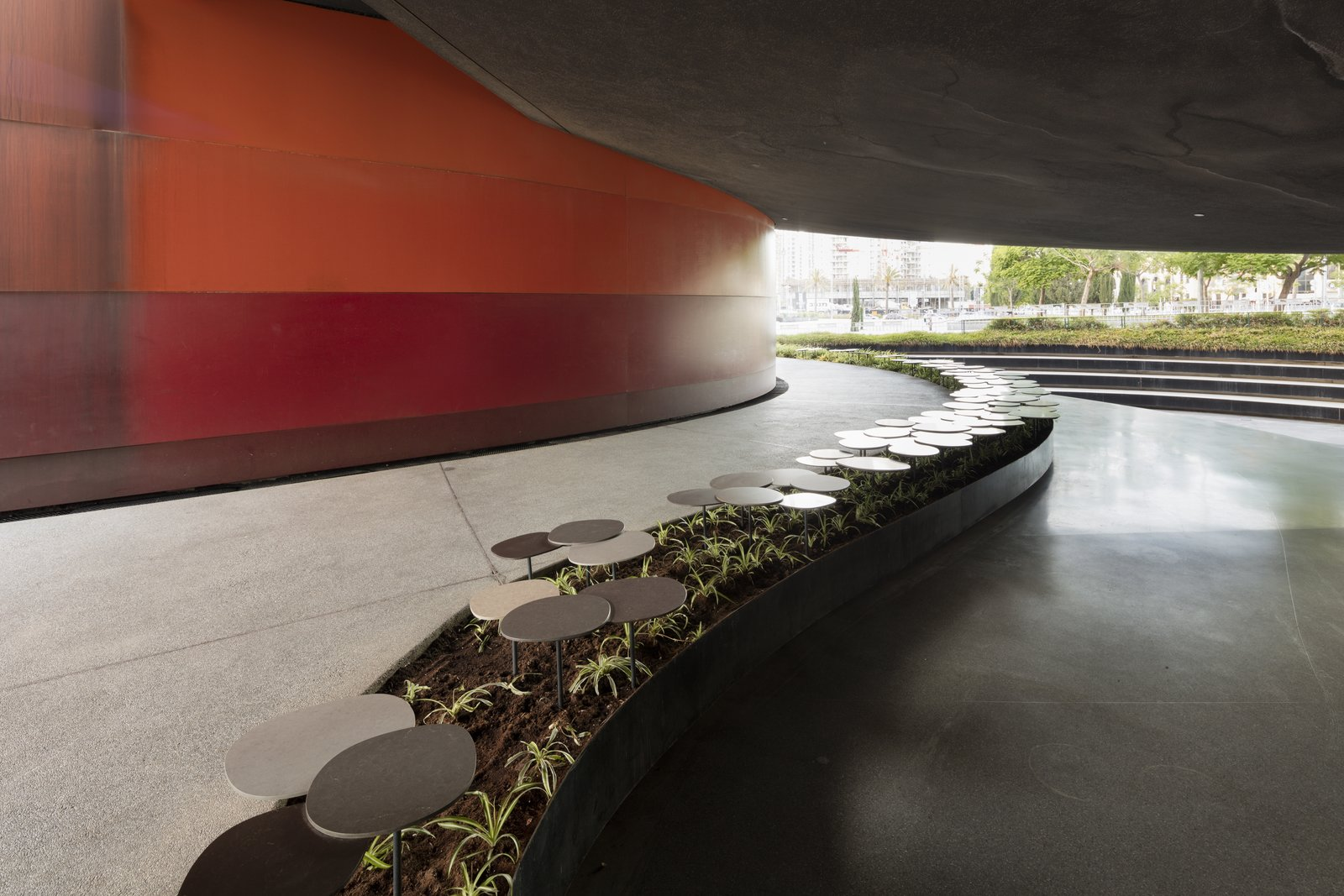 A garden made up of 155 pieces of Caesarstone quartz also meanders through the museum's outdoor space.  Photo 5 of 8 in Nendo's Minimalism Meets Ron Arad's Sweeping Curves
