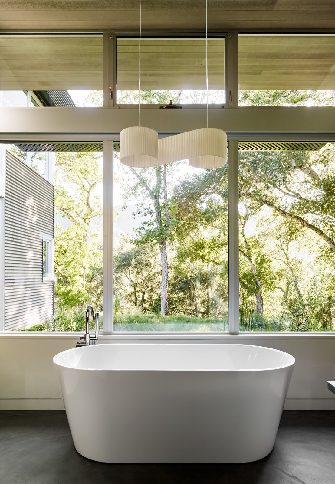 Bath Room, Ceiling Lighting, Pendant Lighting, and Freestanding Tub In the master bath, a Duna pendant by El Torrent hangs above a Blu Stone tub.  Photo 8 of 10 in A Meadow With Amenities