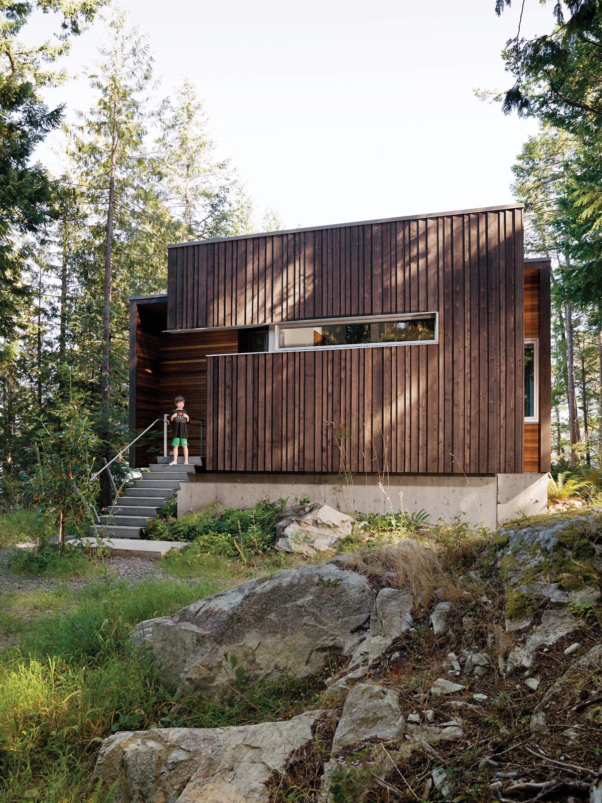 Exterior, Flat RoofLine, House Building Type, Cabin Building Type, and Wood Siding Material The facade is clad with beveled siding, stained dark to meld into the forest.  Cabins & Hideouts
