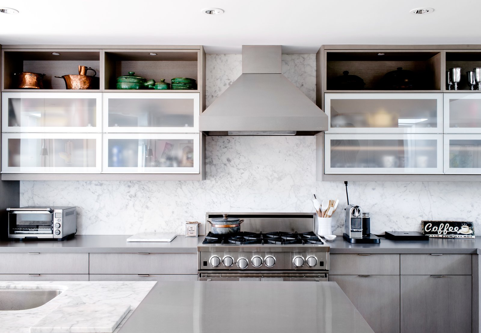 Charred House kitchen with quartz countertops and white open cabinets