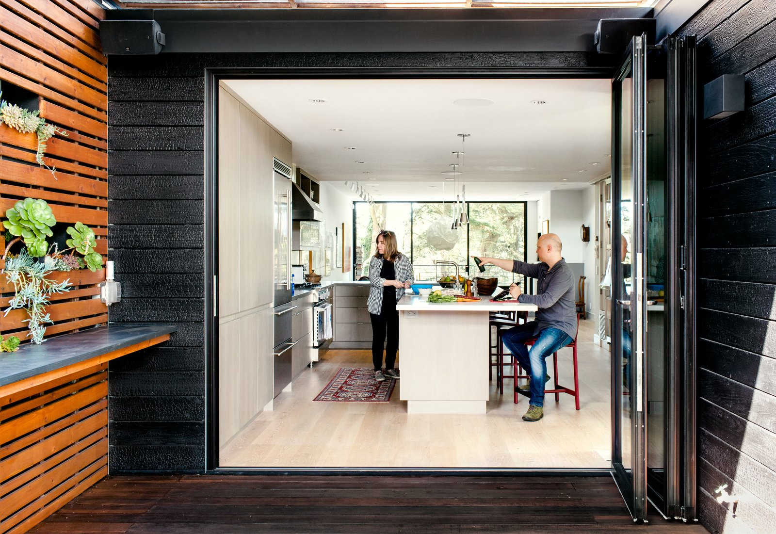 Charred House exterior glass folding doors