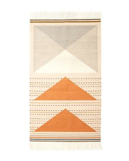 Named after a poem by American writer Mary Oliver, the Wild Geese rug is available in two colorways: peach (shown) and gray.