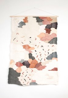 Berks created the Georgia wall hanging, made with natural fibers, by freeform weaving a collage of varying textures and visual motifs.