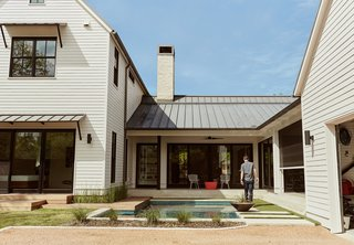 Homeowners Matthew and Lindsay Thomas, who build houses for a living, worked with architects Todd Hamilton and Scott Slagle to create their own residence—a vernacular form characterized by horizontal clapboard cladding and a standing-seam, paint-grip roof.
