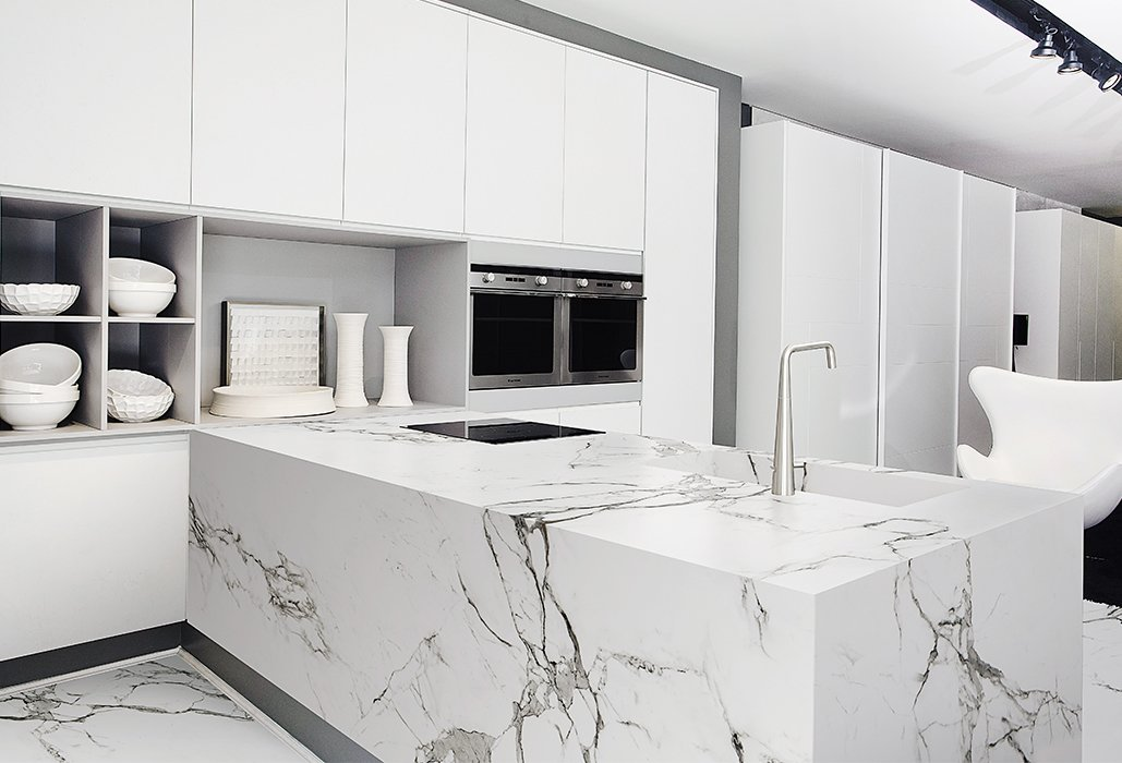 Kitchen, Marble Counter, White Cabinet, Marble Backsplashe, and Marble Floor High-performance materials like Dekton by Cosentino are new alternatives for granite. The surface is scratch-resistant and easier to clean than stone.  Kitchen counters from New Kitchen Materials You Should Know About