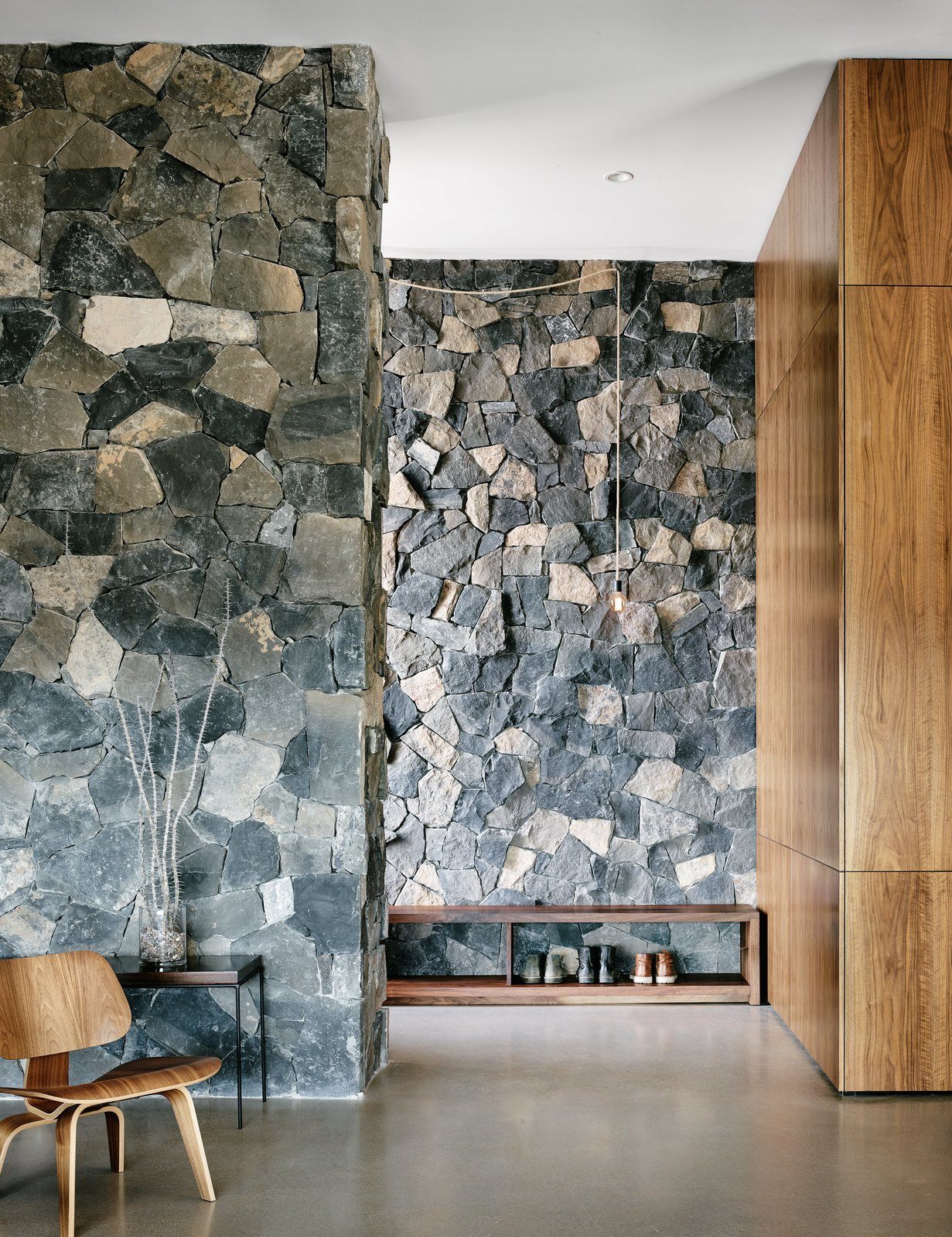 Hallway and Concrete Floor The two basalt layers, meanwhile, showcase American black maple and polished concrete floors.  Photo 4 of 4 in Views Stretch to Mexico at This Hard-Edged Texas Home
