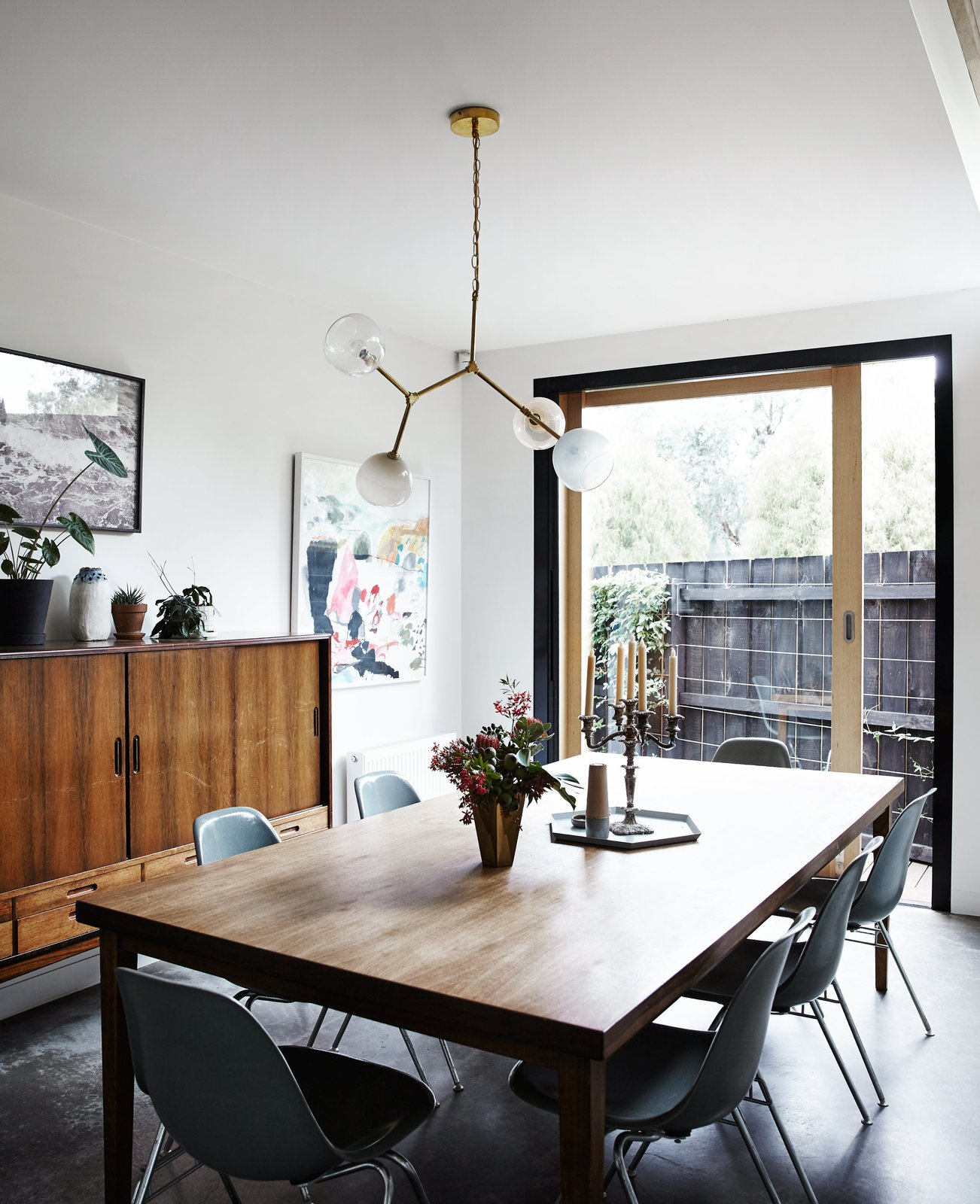 Dining Room, Pendant Lighting, Chair, Table, and Ceiling Lighting A Y chandelier by Douglas and Bec hangs above a vintage table and chairs.  Photo 5 of 12 in An Unassuming Edwardian Saves the Best for Out Back
