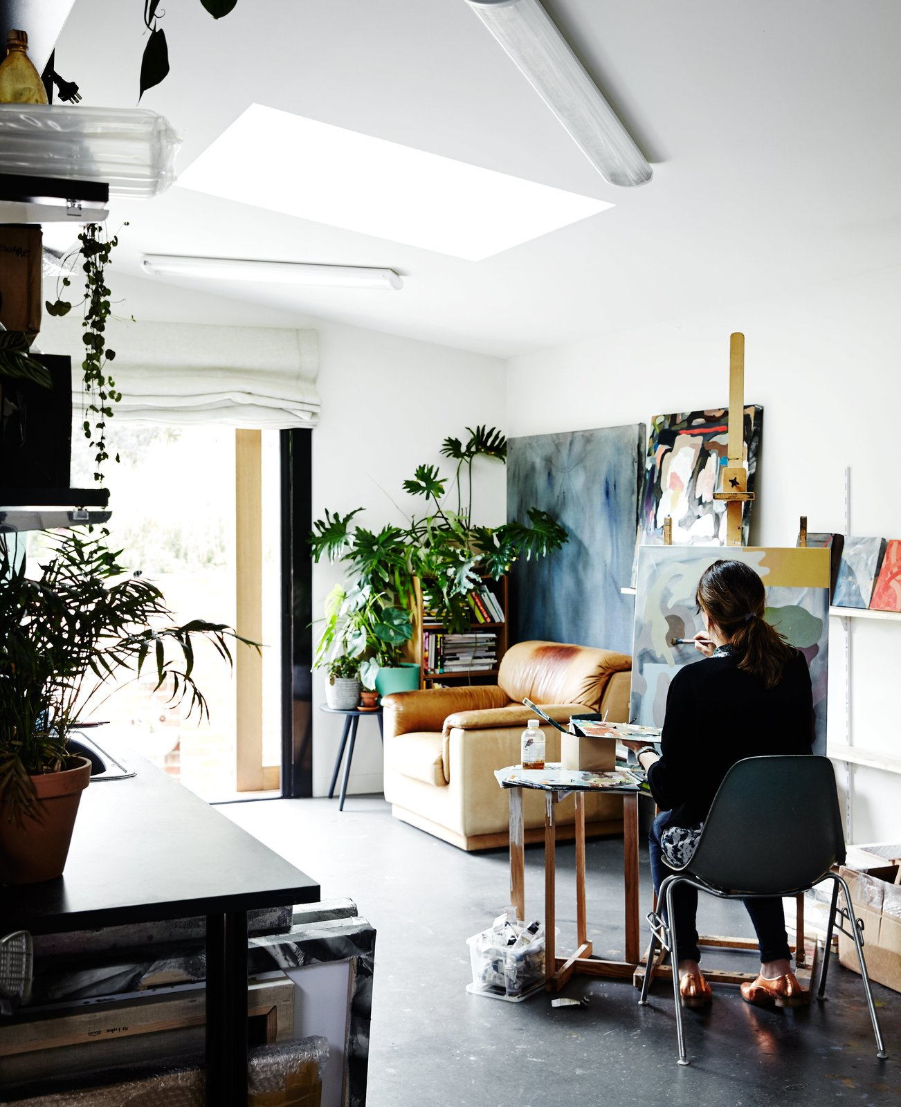 Shed & Studio, Den Room Type, and Living Space Room Type Its timber shiplap cladding tops a concrete blockwork base. Kate uses the main floor as an art studio, where light through a custom skylight illuminates her work space (l  Photo 11 of 12 in An Unassuming Edwardian Saves the Best for Out Back