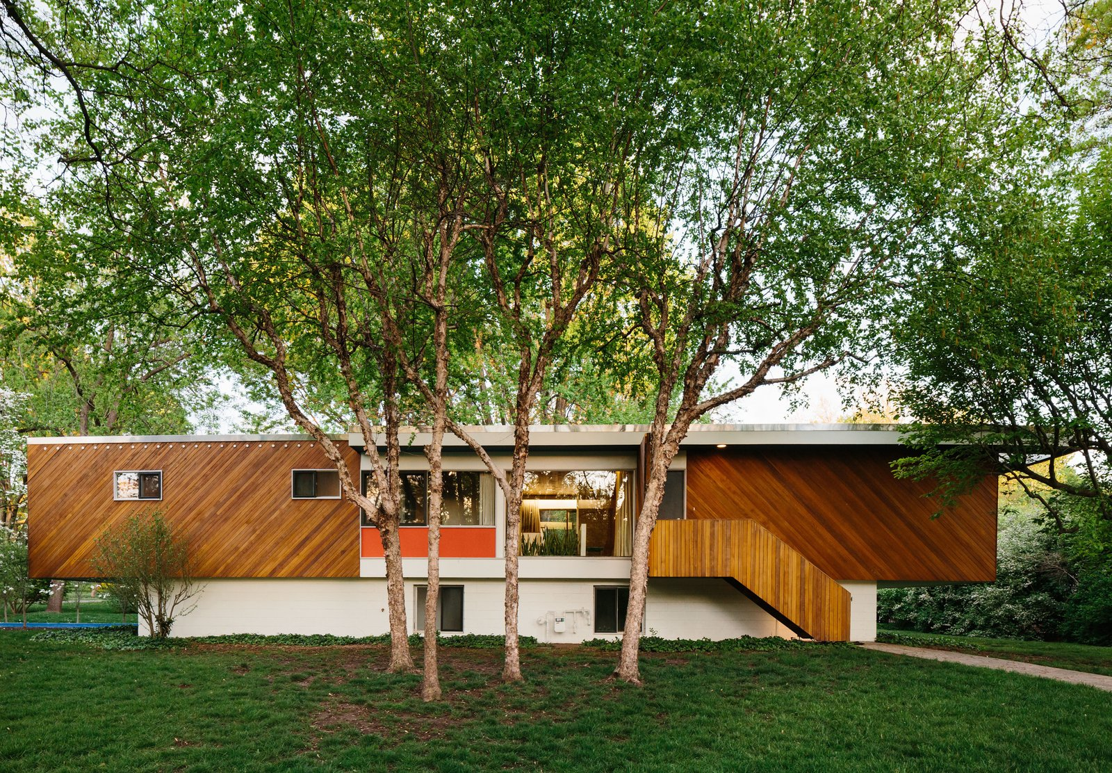 """Exterior, House Building Type, Flat RoofLine, and Wood Siding Material The 1,800-square-foot home features a cantilevered design and diagonal cladding similar to that of Breuer's own 1947 Connecticut residence. Hufft replaced the roof but maintained its flat profile—though finding the correct two-inch metal flashing was a challenge. """"These are the details that make the original what I consider a masterpiece,"""" Hufft says.  Photo 2 of 15 in Kansas City Royal"""