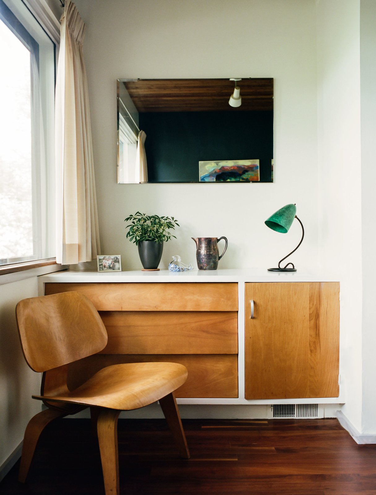 Bedroom, Dresser, Chair, Lamps, and Medium Hardwood Floor Built-in details include a dresser that pairs with an Eames molded plywood lounge chair in a guest bedroom.  Photo 5 of 15 in Kansas City Royal