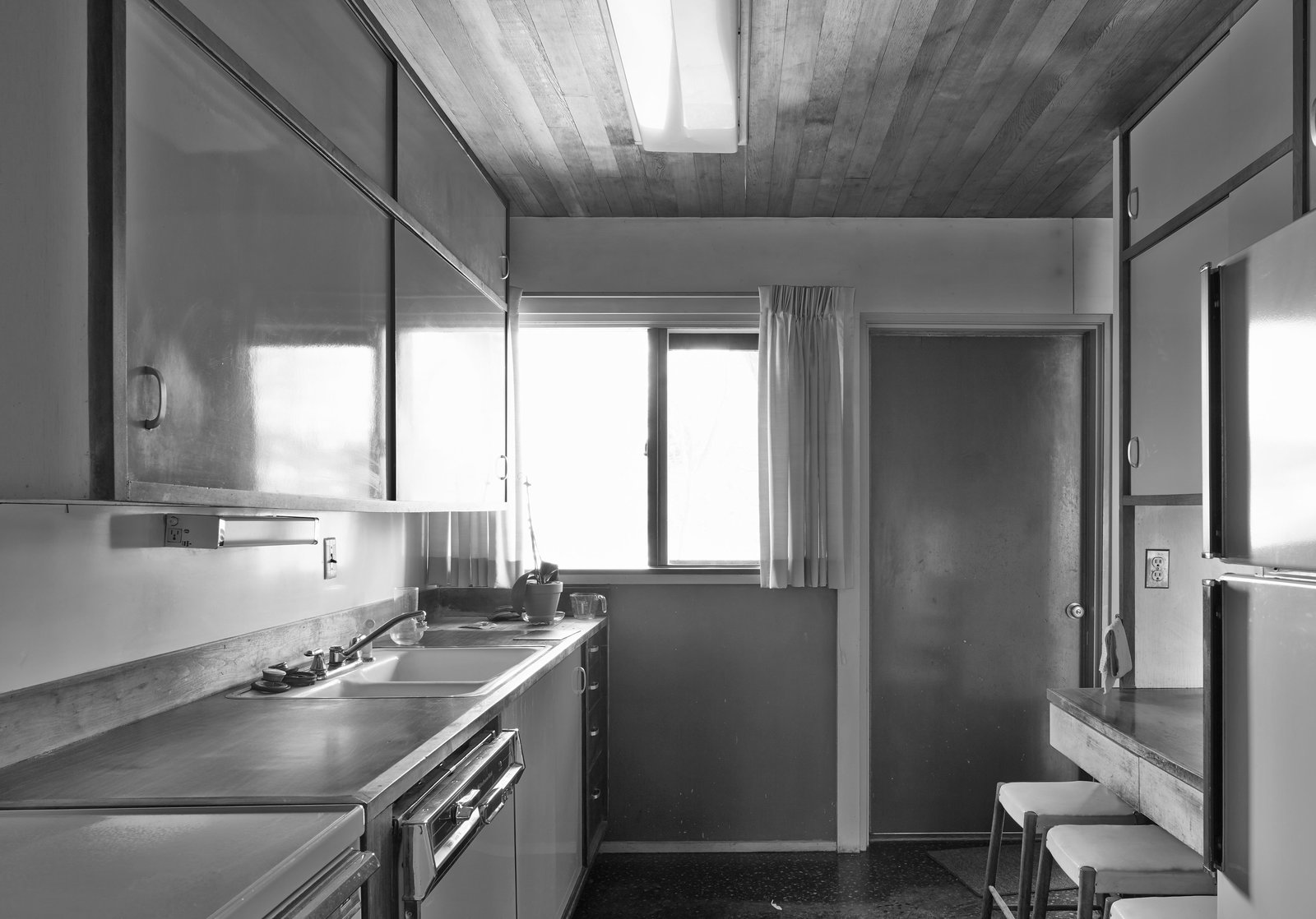 The biggest changes made by Hufft's team were outfitting an outdated kitchen (2) with modern appliances, including a dishwasher and a range by Bosch.  Photo 7 of 15 in Kansas City Royal