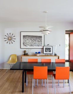 Architect Chris Fein's family home in Kansas is a showcase for modern design pieces, including a Le Corbusier LC6 dining table, chairs by Maarten Van Severen for Vitra, and a Louis Poulsen pendant. The sideboard is a Florence Knoll design from 1952, about the time the house was built.