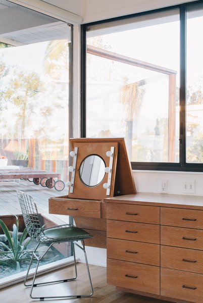 """Situated in a built-in cabinet, a folding vanity in the master bedroom remains as it was when the home was built. """"We knew that with some work, the house could be brought back to a clean and simple classic modern home,"""" Tyler says."""