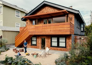 A new cedar deck and facade face drought-tolerant plants and a gravel hardscape, implemented by Cheng with help from Indra Designs.
