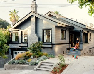 The 1912 Craftsman bungalow appears unchanged from the street, part of Cheng and Snyder's strategy to maintain the neighborhood's existing architectural character and appease local preservationists. A dark-gray finish from Glidden custom matches the home's original color and contrasts with the bright interiors.