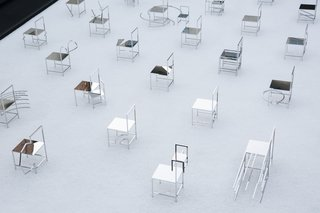 The installation is comprised of 50 stainless steel chairs.