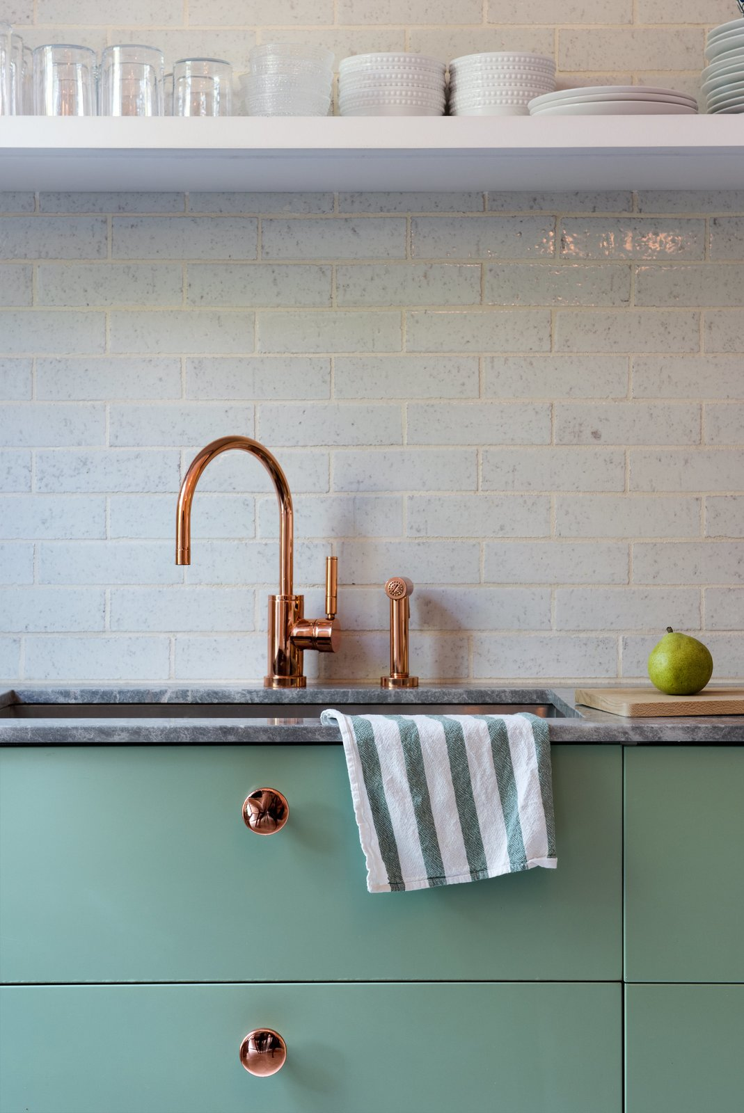 Kitchen, Undermount Sink, and Marble Counter Lyons and Brill designed several custom touches, like the copper-plated knobs they installed on the Sektion kitchen cabinetry from IKEA, painted in Farrow & Ball's muted Breakfast Room Green.  Photo 7 of 14 in Modern Becomes Eclectic in This Renovated Brooklyn Townhouse