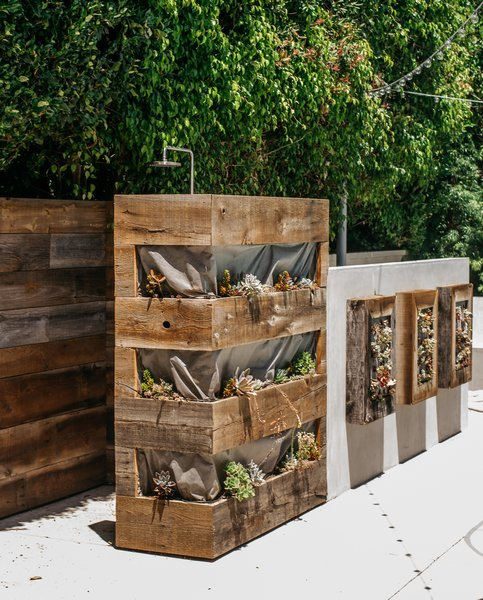 The outdoor shower, which he designed in collaboration with landscape contractors Warren-Avard, is surrounded by reclaimed hemlock planters.