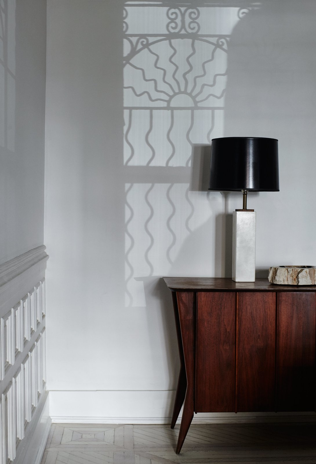 Madelena-Gnewikow Residence with wainscoting along accent wall.