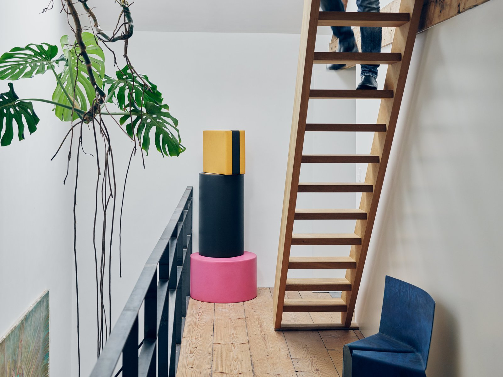 Staircase and Wood Tread A stack of foam poufs from Venlet's colorful, candy-inspired Let's Drop collection joins his blue, powder-coated Cake chair on the third-floor landing.  Photo 2 of 11 in Futuristic Forms Meet Historical Details in Designer Danny Venlet's Brussels Home