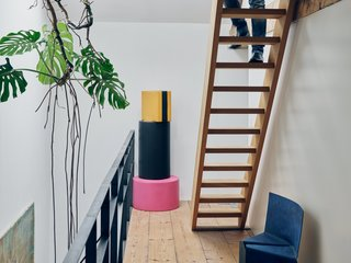A stack of foam poufs from Venlet's colorful, candy-inspired Let's Drop collection joins his blue, powder-coated Cake chair on the third-floor landing.