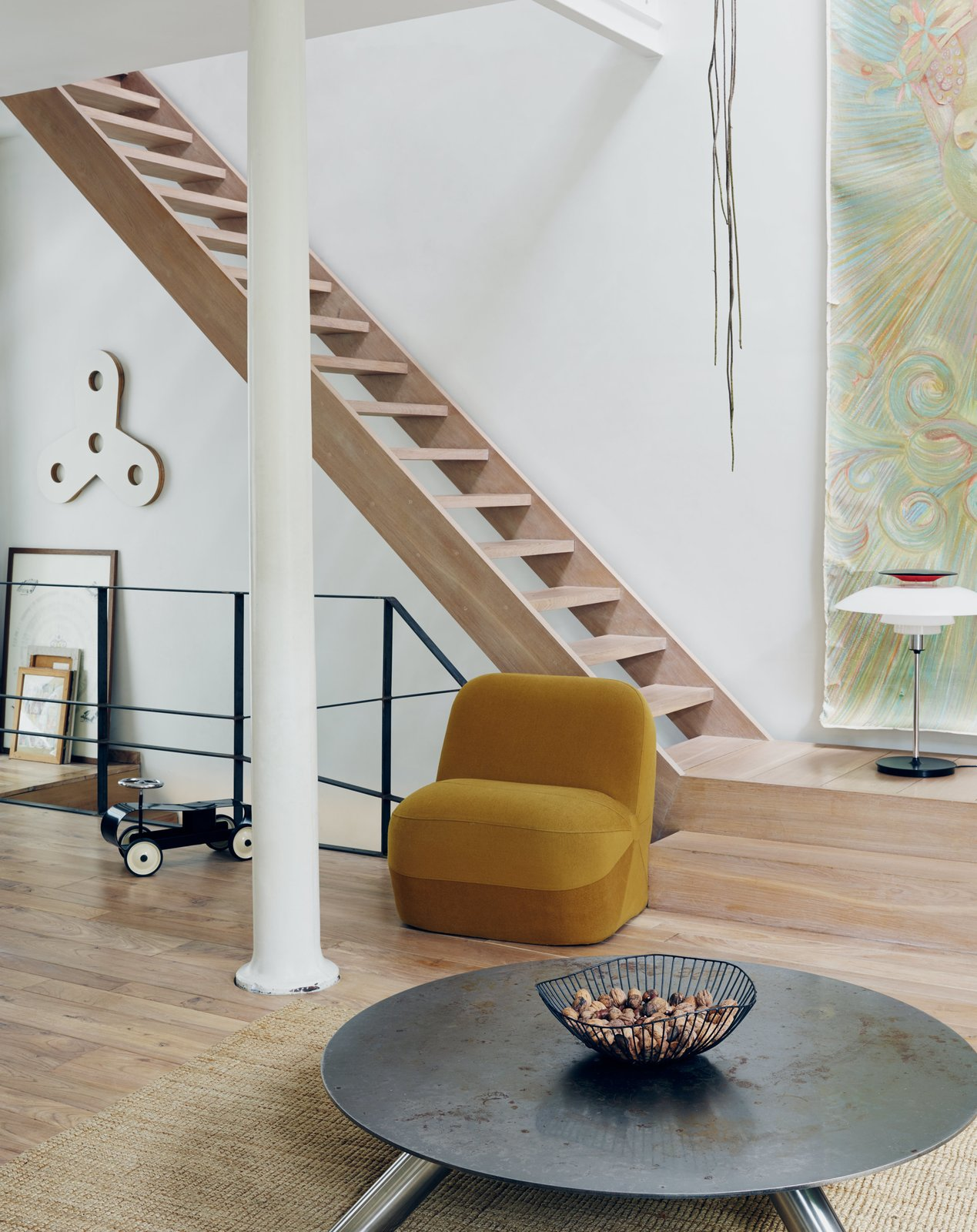 Staircase and Wood Tread Venlet's prototype of the armless Emperor's Hat Chair sits near his Cuppa coffee table, made of Cor-Ten and stainless steel.  Photo 4 of 11 in Futuristic Forms Meet Historical Details in Designer Danny Venlet's Brussels Home