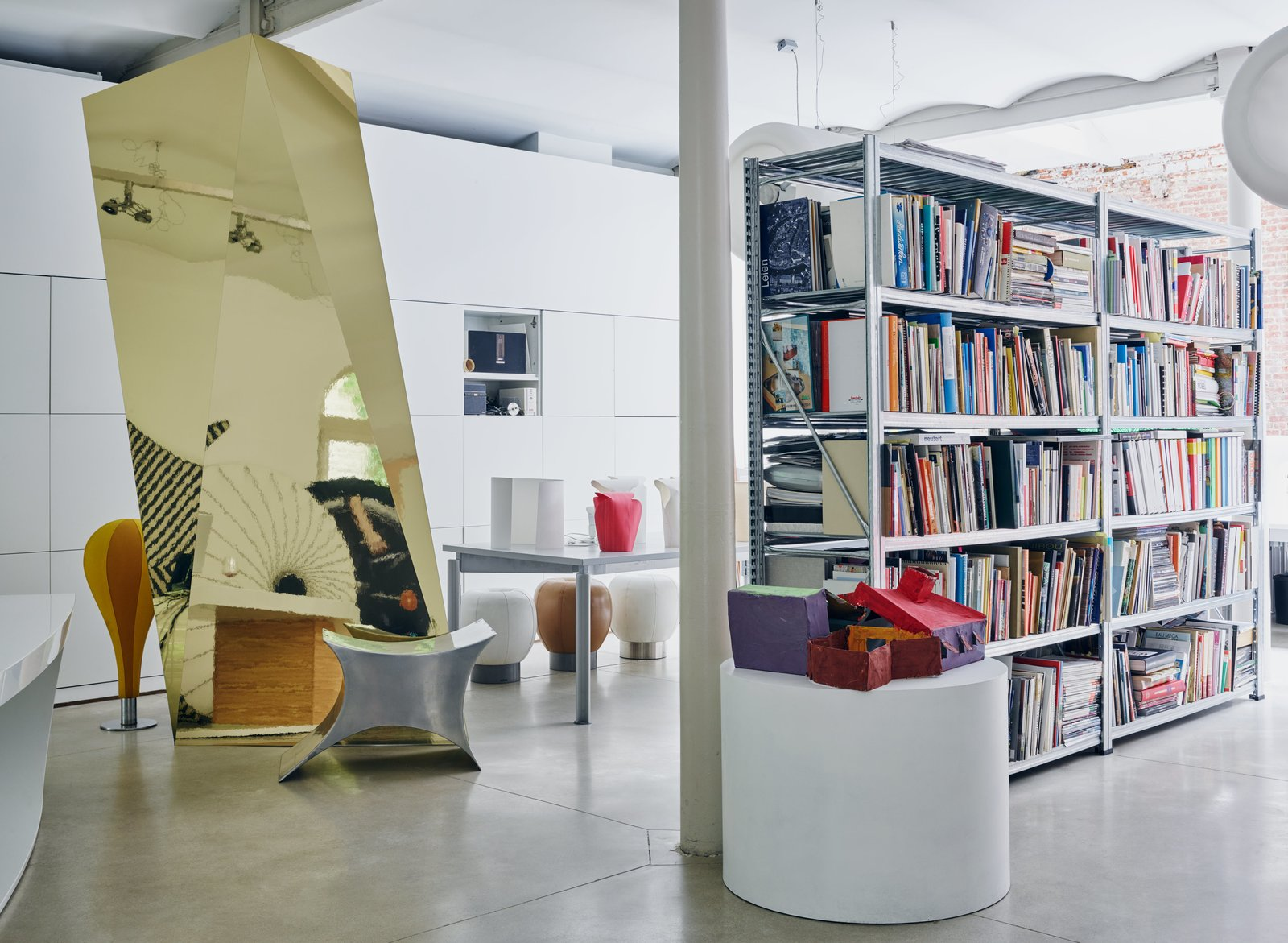 Storage Room and Shelves Storage Type Books, models, and more prototypes—including the 1991 Powder Horse stool, composed of concave stainless-steel surfaces—fill Venlet's atelier.   Photo 9 of 11 in Futuristic Forms Meet Historical Details in Designer Danny Venlet's Brussels Home