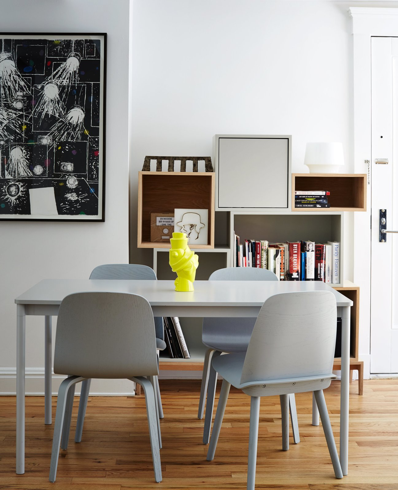 Dining Room, Chair, Table, and Medium Hardwood Floor A neon vase by Michael Geertsen contrasts with a gray Base table by Mika Tolvanen and coordinating Nerd and Visu chairs, all for Muuto.  Photo 8 of 14 in A Danish Design Kingpin Moves to NYC with a Shipping Container of Furniture in Tow