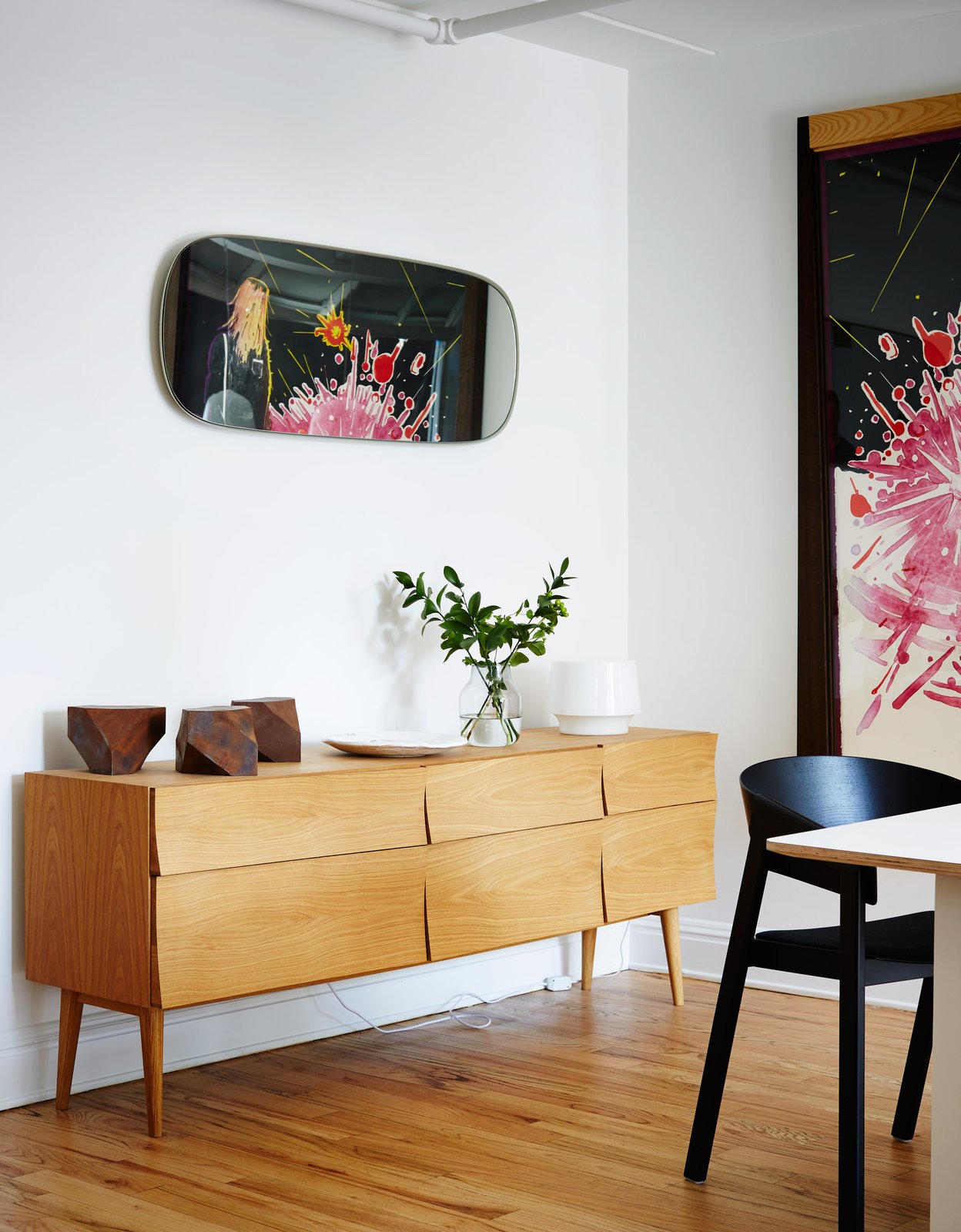 Dining Room and Storage In the opposite communal area, which is separated by the kitchen, a Reflect sideboard by Søren Rose holds a white Cosy lamp by Harri Koskinen and a vase by Andreas Engesvik.  Photo 9 of 14 in A Danish Design Kingpin Moves to NYC with a Shipping Container of Furniture in Tow
