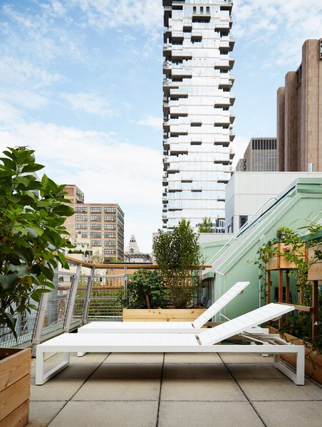 The top terrace, outfitted with Eos lounge chairs from Design Within Reach, has an unobstructed view of Herzog & de Meuron's 56 Leonard Street.