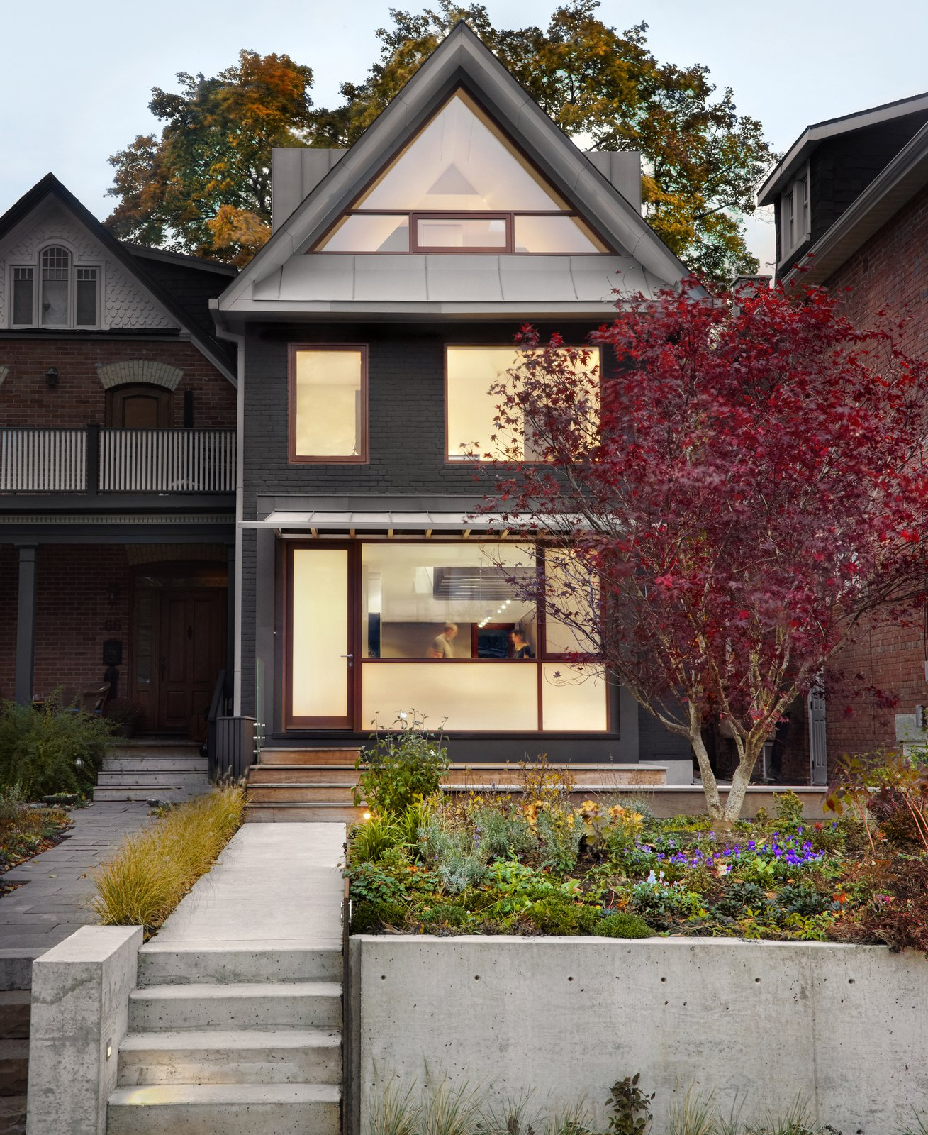 The triangular window from the bedroom looks out towards the street. The window includes a custom blind for shading. A zinc awning covers the front door.  Photo 20 of 21 in A Spotlight on 10 Traditional Homes with Modern Interiors from Not Your Grandma's Victorian