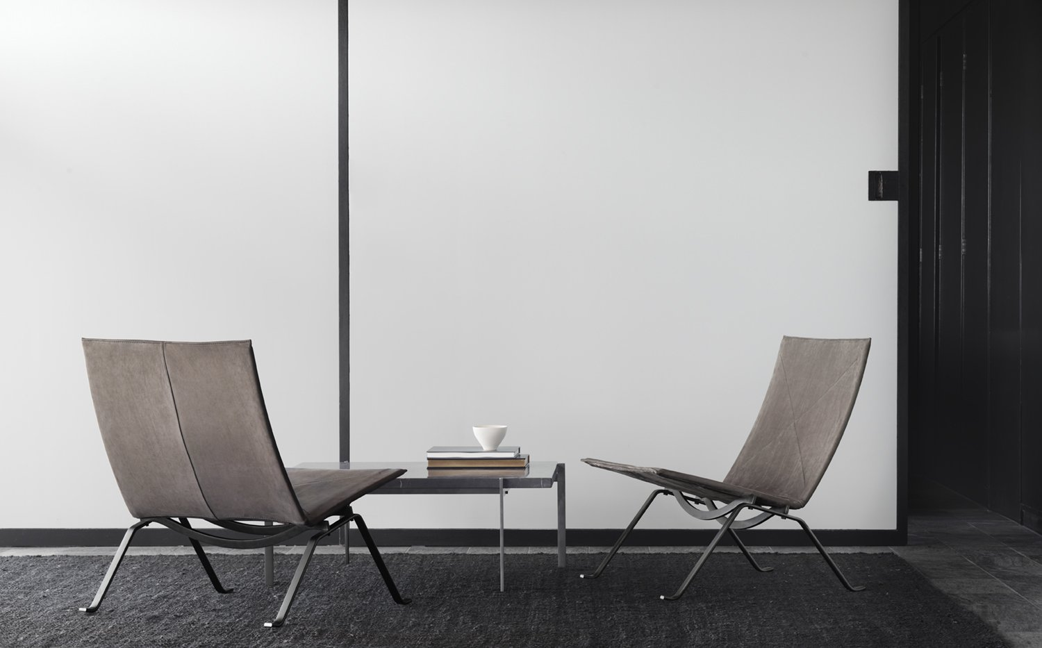 Designed to accompany the PK22, the PK61 was also released in 1956. The limited-edition version is topped Petra marble and the steel surface is treated with electroplated anthracite.  Photo 7 of 11 in 10 Things You Didn't Know About Poul Kjærholm