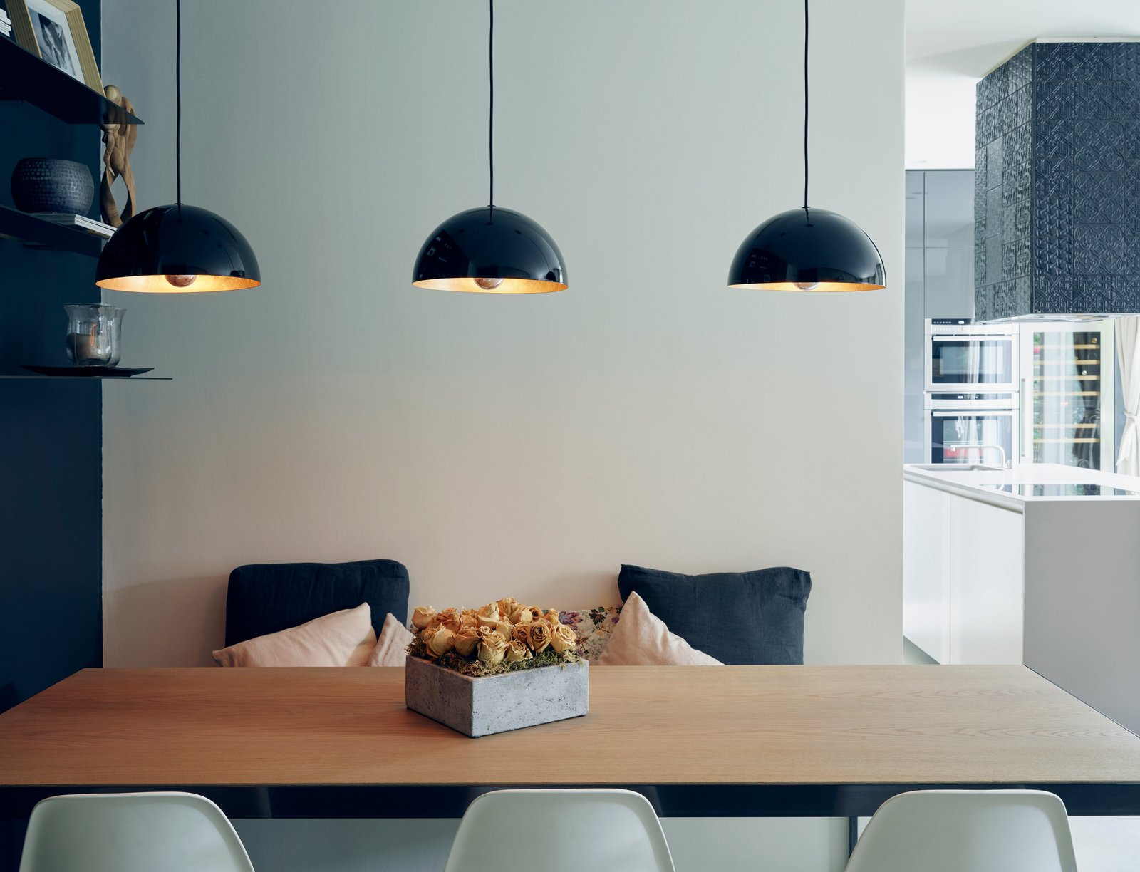 Dining Room, Table, Pendant Lighting, Chair, Lamps, and Ceiling Lighting A dining nook sits just inside the entrance of Andrea Maffei and Rossella Acierno's 850-square-foot residence.  Photo 3 of 15 in This Growing Family Maximizes Every Last Inch in Their 850-Square-Foot Apartment