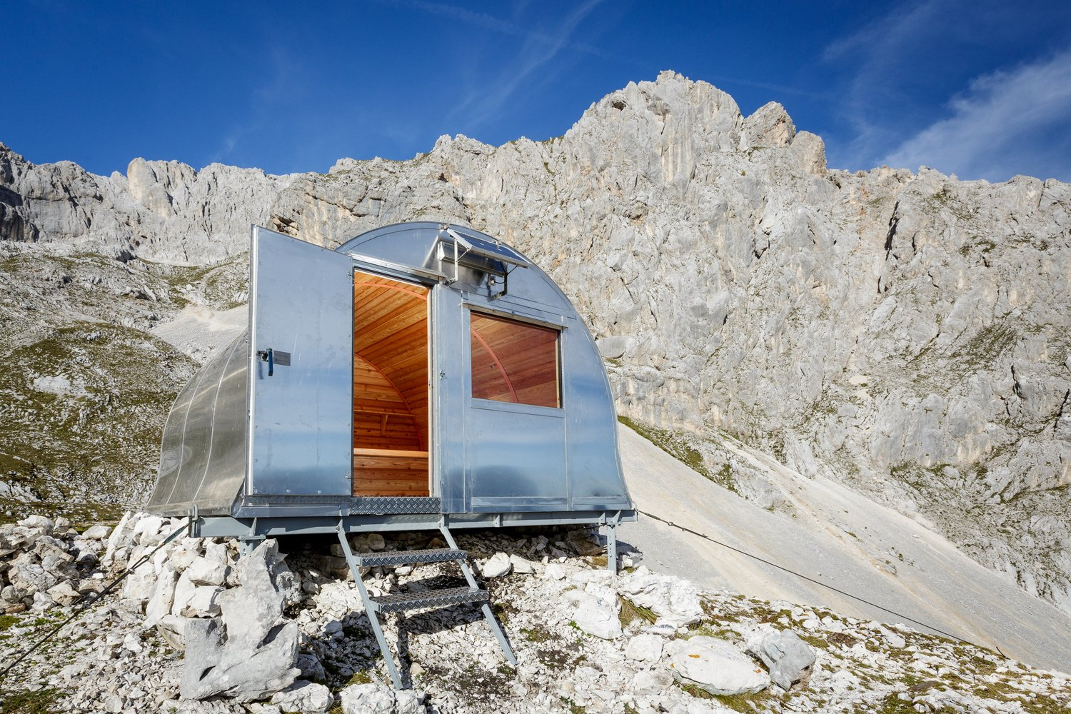 Via ArchDaily, photo by Anze Cokl.  Cabins & Hideouts