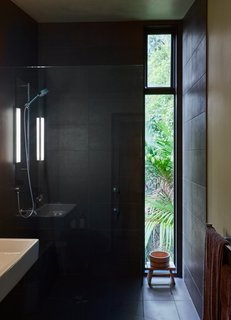 The shower is lined in Magma Black tile purchased at the Tile Space in Auckland.