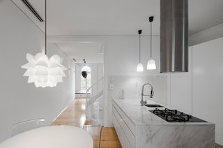 Natural materials are contrasted with white surfaces.