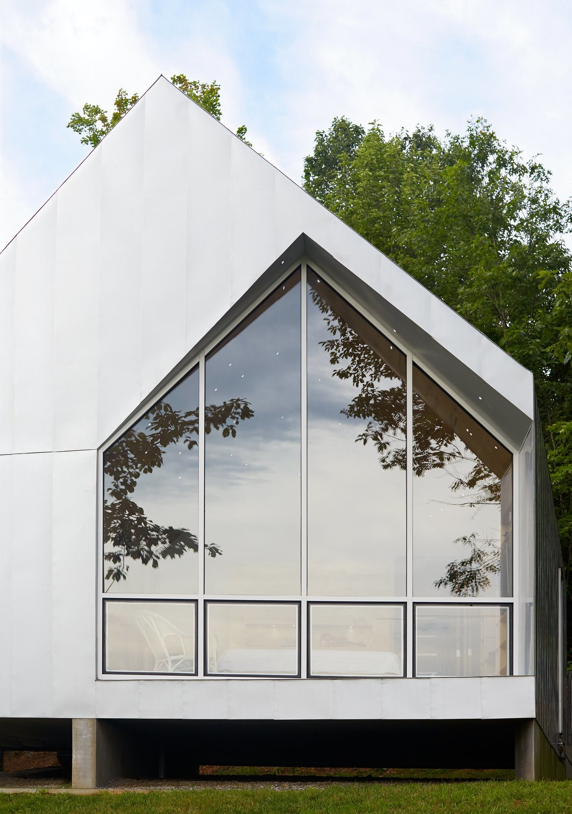 Exterior and House Building Type The building frame was digitally prefabricated by Tri-State Components using a computer model developed by the architects, Marie and Keith Zawistowski.  Photo 3 of 8 in Happy Trails