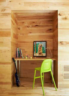 A recess in the wall fits a custom desk and IKEA chair.