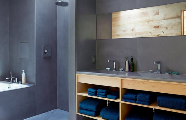HardLife Products manufactured the bathroom's custom concrete walls, floor slabs, and sink basins, which are paired with faucets by American Standard.