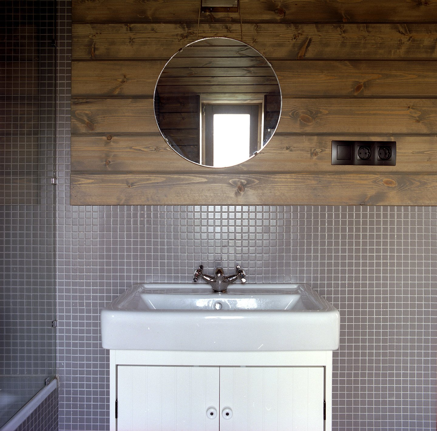 By the entrance to the master suite, a mirror sits on a table of Ovchinnikov's design. Tagged: Bath Room, Drop In Sink, Vessel Sink, and Enclosed Shower.  Photo 7 of 8 in Seeing Double