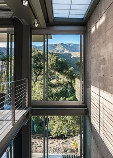 """A steel-and-glass stairway keeps things open. Structural steel contractor Russ Jones was a key player. """"Wood is easily manipulated on site; you can push and shove it,"""" Hector says. """"Steel is different. It requires a steel erection team."""""""