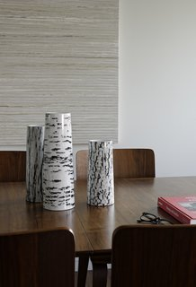 The three stoneware vases featuring an abstracted wood-bark pattern are from the Modern by Dwell Magazine collection.