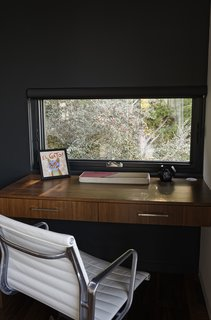 Chris designed a custom built-in desk in the den for Ellen, who often works from home.
